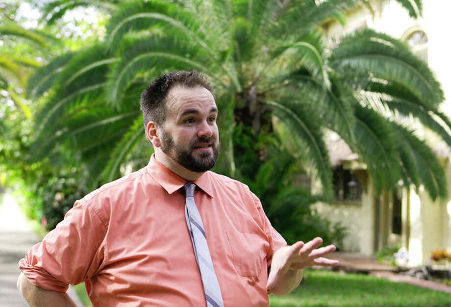 In this Saturday, Dec. 21, 2013 photo, in Orlando, Fla., Adam Mayfield explains he moved to Florida because he knew he could easily find a job in Orlando after he was laid off in Atlanta last year. Sometime next year, Florida will surpass New York in population and become the nation's third-most populous state. (AP Photo/John Raoux) / AP