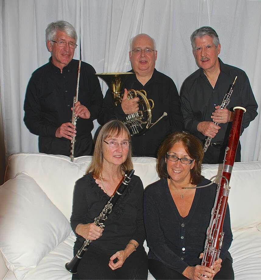 "Madera Winds performs at Wilton Library's Connecticut's Own concert on Sunday, Jan. 11, from 4-5 p.m. with a program entitled, ""Summer in Winter."" The quintet is comprised of (l-r, back row): Jan van den Berg (flute), John Harley (horn), Ralph Kirmser (oboe); (l-r, seated): Janet Atherton (clarinet) and Rosemary Dellinger (bassoon)."