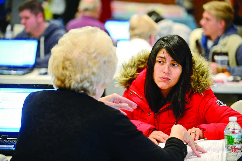 "Hour photo / Erik Trautmann Norwalk Community College student Paola Bastidas enrolls in the spring semester with help from Social and Behavioral Science teacher Carol Harker during the ""Super Saturday Registration Blitz"" on Saturday, January 9, 2016 in the East Campus Atrium."