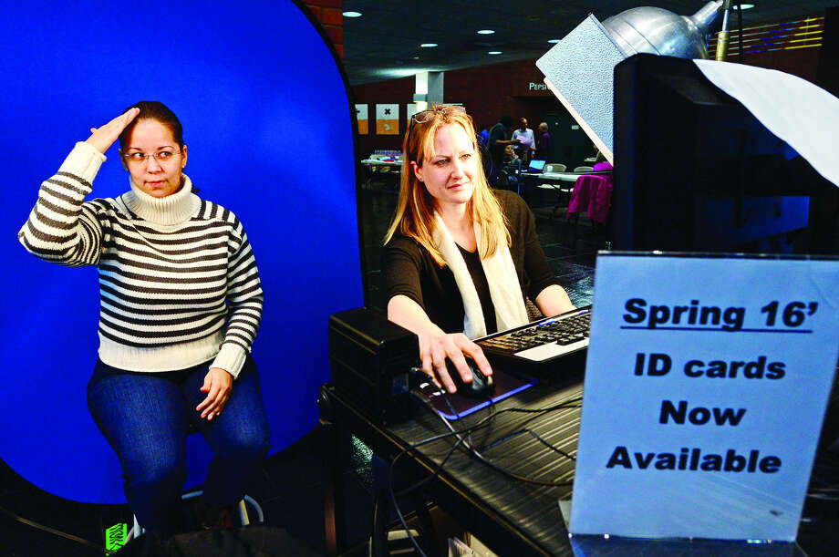 "Hour photo / Erik Trautmann Norwalk Community College student Rita Rodriguez gets her photo ID for her first semester with help from NCC security officer Althea Tomasky during the ""Super Saturday Registration Blitz"" on Saturday, January 9, 2016 in the East Campus Atrium."