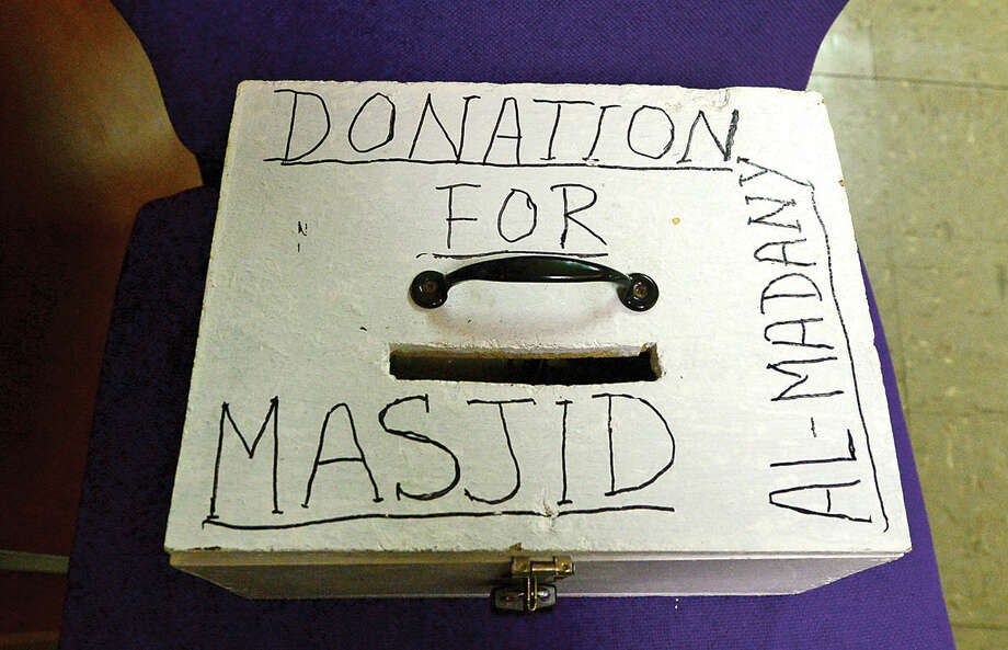 Hour photo / Erik Trautmann Muslims are asked to donate toward the new home of the Al Madany mosque on Park St in Norwalk Friday.