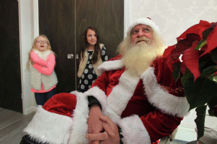 Hour photo / Chris PalermoElena Abshire and Emily Gillen have a chat with Santa (Rich Glica) at the grand opening of The Runway, a children's party place at 21 First St., recently. / © 2013 Hour Newspapers All Rights Reserved.