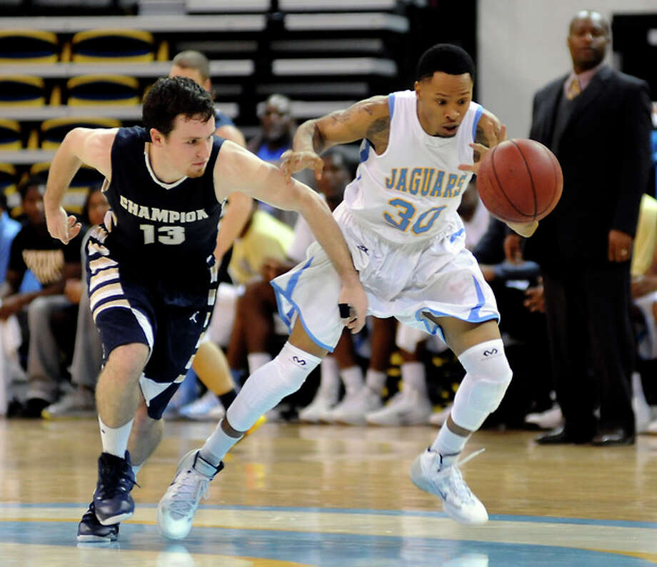Southern's Tre Lynch, right, runs down a loose ball ahead of Champion Baptist's Tim Gillespie,left, Monday Dec. 30, 2013, during an NCAA college basketball game in Baton Rouge, La. Southern defeated Champion Baptist 116-12. (AP Photo/The Advocate, John Oubre) / The Baton Rouge Advocate