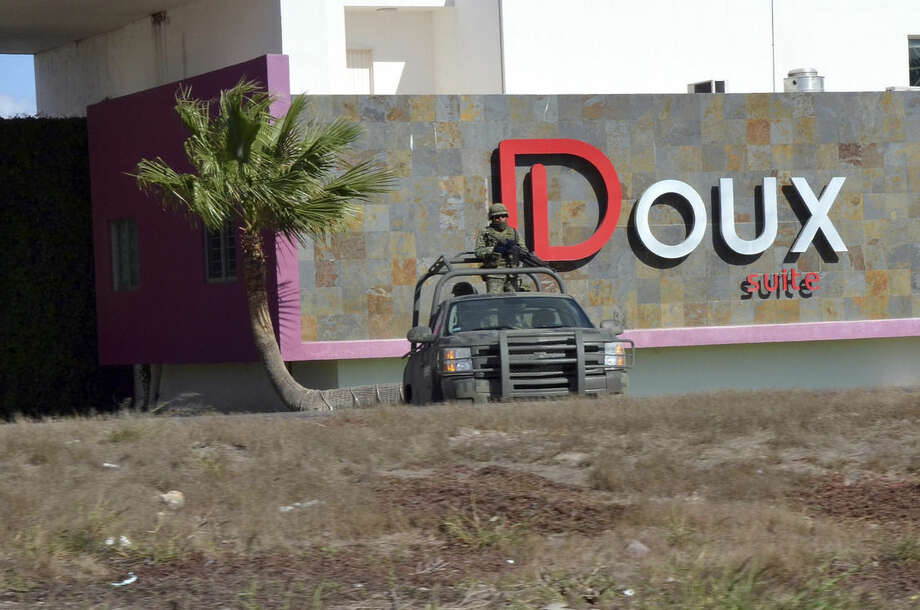"A Mexican army vehicle stands guard outside of a motel wheere Mexico's most wanted drug lord, Joaquin ""El Chapo"" Guzman was captured, in the city of Los Mochis, Mexico, Friday, Jan. 8, 2016. The world's most-wanted drug lord was captured for a third time, as Mexican marines staged heavily-armed raids that caught Guzman six months after he escaped from a maximum security prison.(Carlos Paulino via AP/EL DEBATE)"