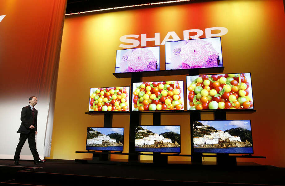 Toshiyuki Osawa, president of Sharp Electronics Corporation, introduces Sharp 4K Ultra HD televisions Monday, Jan. 5, 2015, in Las Vegas. Also known as Ultra HD, 4k offers four times the sharpness of today's high-definition video. (AP Photo/John Locher)