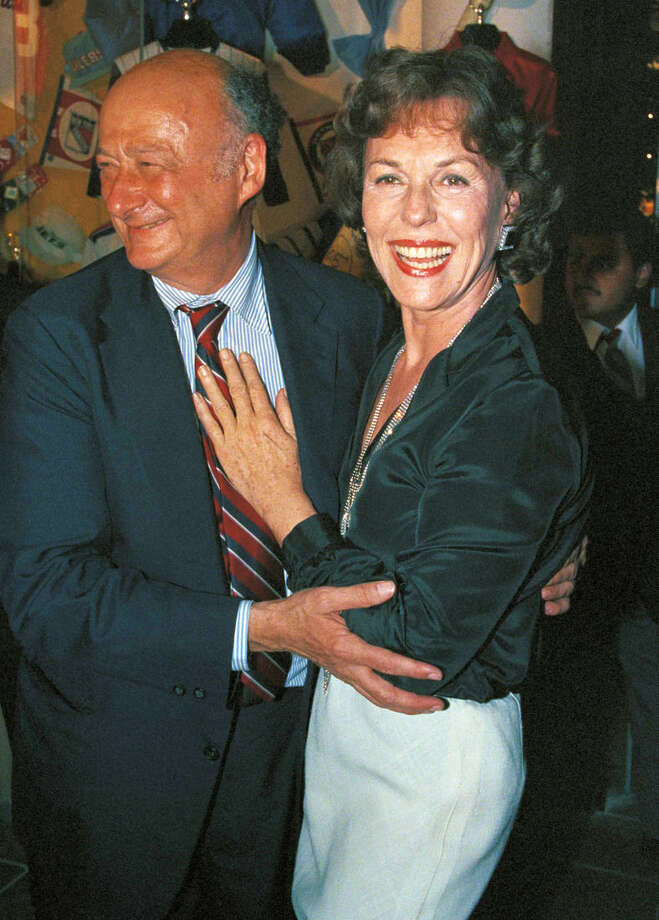 FILE - In this May 14, 1985 file photo, New York Mayor Edward Koch, left, poses with former Miss America Bess Myerson in New York. Myerson, the first Jewish Miss America who parlayed her stunning 1945 victory into national celebrity, died Dec. 14, 2014, at her home in Santa Monica, Calif. She was 90. She landed a series of television jobs before her appointment as New York City's chief consumer watchdog in 1969. Myerson helped Koch win the 1977 mayoral race. (AP Photo/Carlos Rene Perez, File)