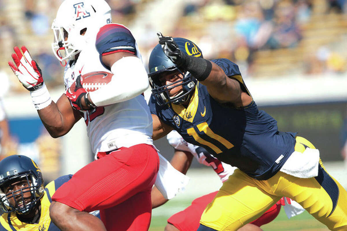Michael Pimentel/GoldenBearSports.com Cal linebacker Khairi Fortt, right, pursues an Arizona running back during a Nov. 2 game in Berkeley, Cal. A former Stmford High standout, Fortt has decided to leavue Call following his junior season and make himself eligible for the NFL draft.