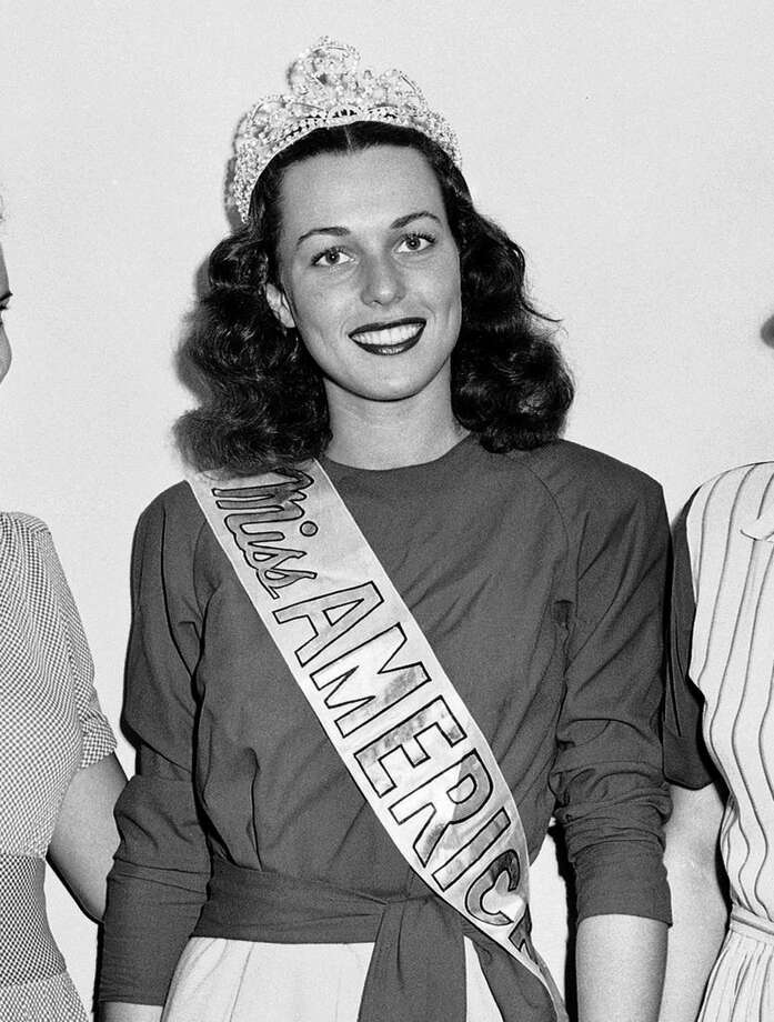 FILe - In this Sept. 8, 1945 file photo, Miss America, Bess Myerson, center, poses at the annual Beauty Pageant held at Atlantic City, N.J. Myerson, the first Jewish Miss America who parlayed her stunning 1945 victory into national celebrity, died Dec. 14, 2014, at her home in Santa Monica, Calif. She was 90. She landed a series of television jobs before her appointment as New York City's chief consumer watchdog in 1969. (AP Photo/Sam Myers, File)
