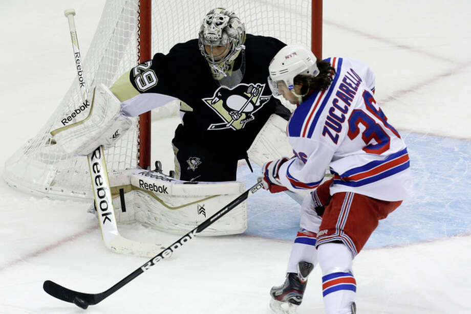 New York Rangers' Mats Zuccarello (36) cannot get a shot off in front of Pittsburgh Penguins goalie Marc-Andre Fleury (29) in the first period of an NHL hockey game in Pittsburgh, Friday, Jan. 3, 2014. (AP Photo/Gene J. Puskar) / AP