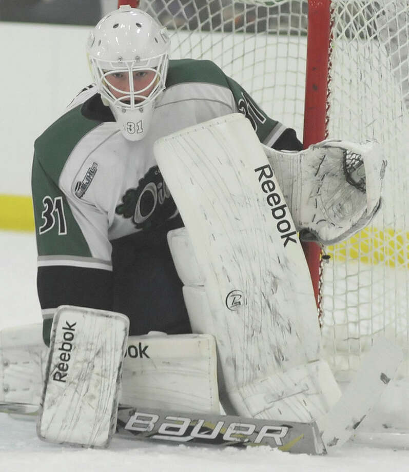 Hour photo/John NashConnecticut Oilers goaltender Nik Nugnes gave up the shot at one scholarship and was rewarded with another, from one of the top college hockey programs in the country.