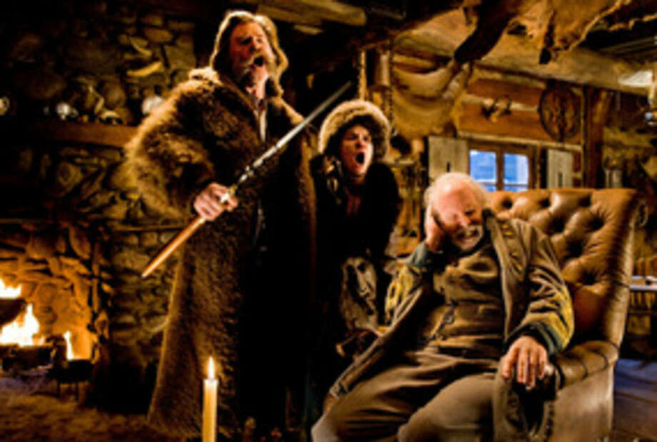 "This photo provided by The Weinstein Company shows, Kurt Russell, from left, Jennifer Jason Leigh, and Bruce Dern, in a scene from the film, ""The Hateful Eight,"" directed by Quentin Tarantino. The movie opens in U.S. theaters on Jan. 1, 2016. (Andrew Cooper/Weinstein Company via AP)"