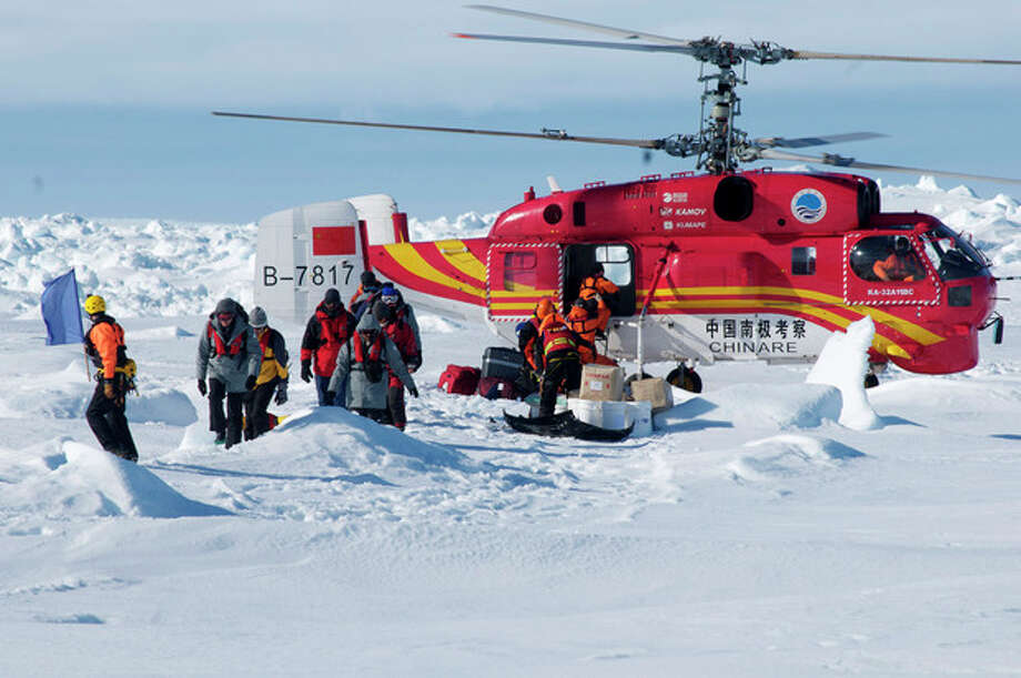 In this image provided by Australasian Antarctic Expedition, A Chinese helicopter arrives to rescue some of the 52 passengers trapped for more than a week on the icebound Russian research ship MV Akademik Shokalskiyin , Thursday, Jan. 2, 2014. The helicopter rescued all 52 passengers from the research ship that has been trapped in Antarctic ice, 1,500 nautical miles south of Hobart, Australia, since Christmas Eve after weather conditions finally cleared enough for the operation Thursday. (AP Photo/Australasian Antarctic Expedition, Jessica Fitzpatrick) EDITORIAL USE ONLY, ONE TIME USE ONLY, NO ARCHIVES; NO SALES / Australasian Antarctic Expedition