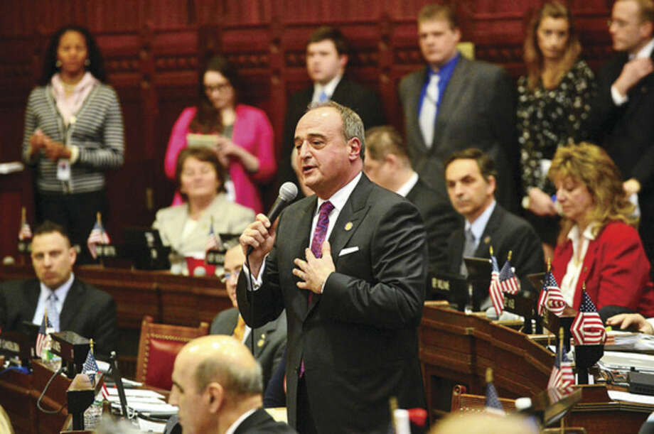 Hour file photo/Erik TrautmannColleagues in the Connecticut Legislature bid farewell to Minority Leader Larry Cafero (R-142) as he announces that he would not seek re-election on March 26, 2014, at the Capitol.