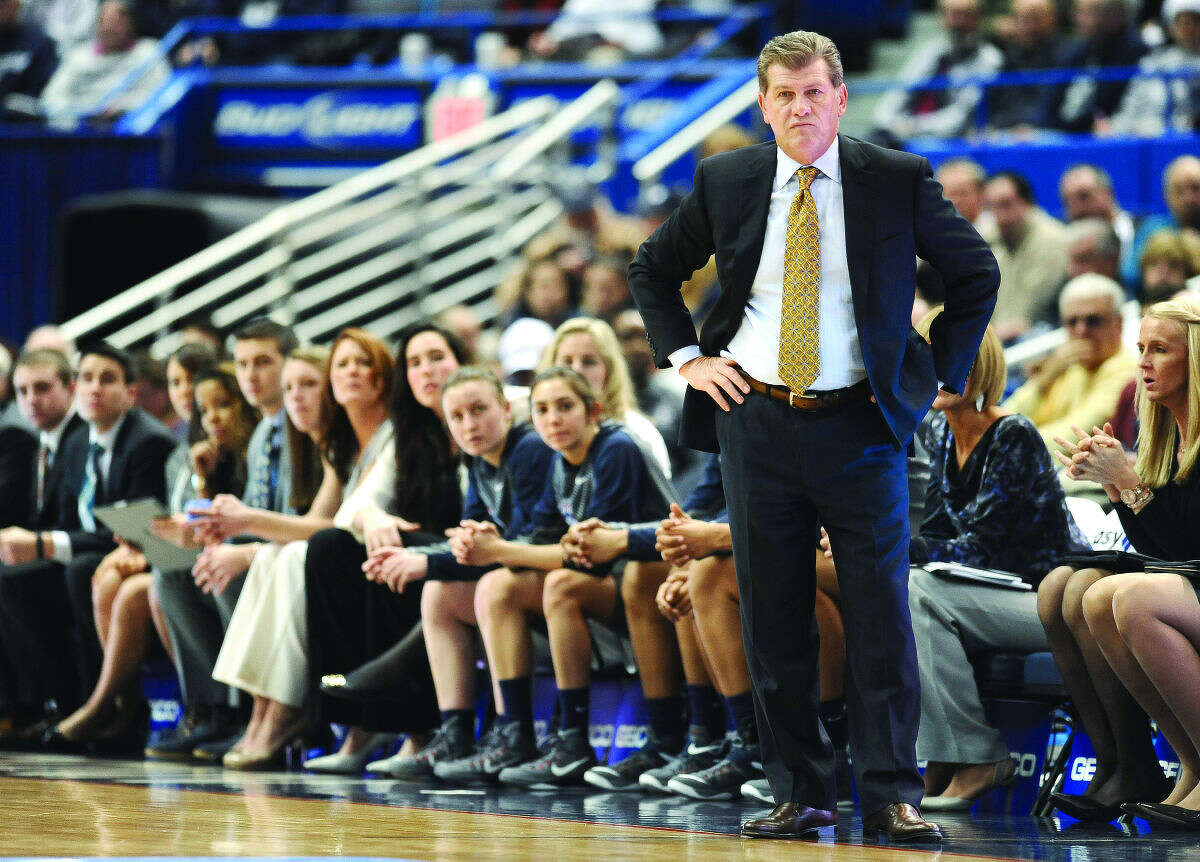 Connecticut Geno Auriemma watches play during the first half of an NCAA college basketball game against SMU, Saturday, Dec. 27, 2014, in Hartford, Conn. (AP Photo/Jessica Hill)