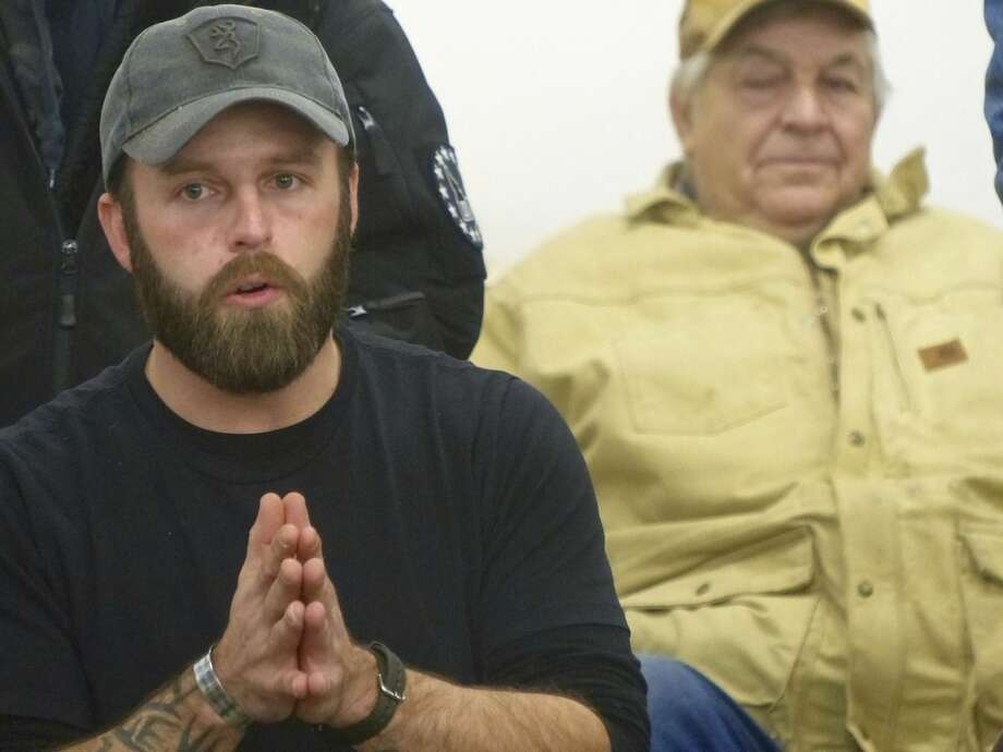 Ryan Payne, an Army veteran from Montana, participates in a community meeting in Burns, Ore., on Friday, Jan. 1, 2016. He was among key militiamen who seized control of the Malheur National Wildlife Refuge after a peaceful protest parade in Burns on Saturday. (Les Zaitz/The Oregonian via AP) MAGS OUT; TV OUT; NO LOCAL INTERNET; THE MERCURY OUT; WILLAMETTE WEEK OUT; PAMPLIN MEDIA GROUP OUT; MANDATORY CREDIT