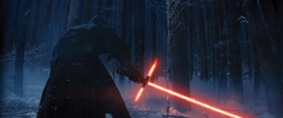 "This photo provided by Disney shows, Adam Driver as Kylo Ren with his Lightsaber in a scene from the new film, ""Star Wars: The Force Awakens."" (Film Frame/Disney/Copyright Lucasfilm 2015 via AP)"