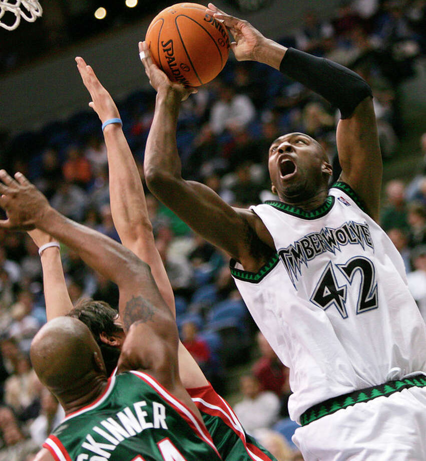 FILE - In this Oct. 11, 2006, file photo, Minnesota Timberwolves' Vin Baker, right, eyes the basket as he goes up for a shot over Milwaukee Bucks' Brian Skinner and another defender during an NBA basketball game in Minneapolis. Dennis Rodman has named a team of former NBA players to participate in an exhibition basketball game in Pyongyang, North Korea. Rodman leads a team that includes former NBA All-Stars Kenny Anderson, Cliff Robinson, and Baker. Craig Hodges, Doug Christie and Charles D. Smith are on the team, as well. They will play against a top North Korean Senior National team on Jan. 8, marking Kim Jong Un's birthday. (AP Photo/Jim Mone, File) / AP