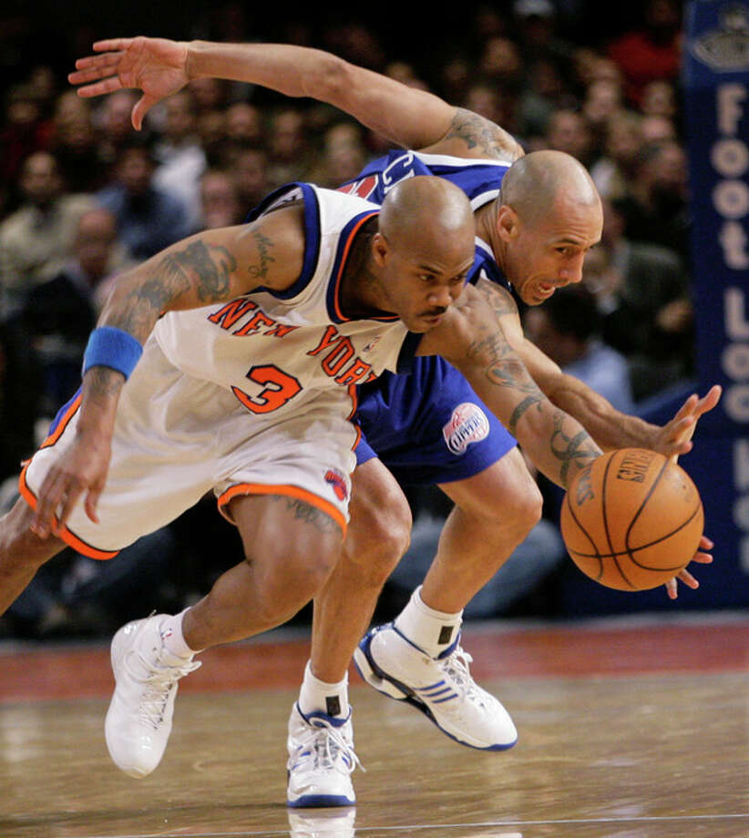 FILE - In this Feb. 6, 2007, file photo, New York Knicks' Stephon Marbury (3) and Los Angeles Clippers' Doug Christie fight for a loose ball during the fourth quarter of an NBA basketball game in New York. Dennis Rodman has named a team of former NBA players to participate in an exhibition basketball game in Pyongyang, North Korea. Rodman leads a team that includes former NBA All-Stars Kenny Anderson, Cliff Robinson, and Vin Baker. Craig Hodges, Christie and Charles D. Smith are on the team, as well. They will play against a top North Korean Senior National team on Jan. 8, marking Kim Jong Un's birthday. (AP Photo/Mary Altaffer) / AP