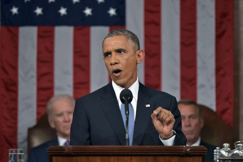 "FILE - In this Jan. 20, 2015 file-pool photo, President Barack Obama delivers his State of the Union address to a joint session of Congress on Capitol Hill in Washington. President Barack Obama is returning to the rancor of the nation's capital Sunday after two weeks of fun and sun in his native Hawaii, saying he's ""fired up"" for his final year in office and ready to tackle unfinished business. His final State of the Union address, scheduled for Jan. 12, 2016, is a high-profile opportunity for the president to try to reassure the public about his national security stewardship after the terrorism attacks in Paris and San Bernardino, Calif. Vice President Joe Biden and then-House Speaker John Boehner of Ohio, listen in the background. (Mandel Ngan, File-Pool via AP)"