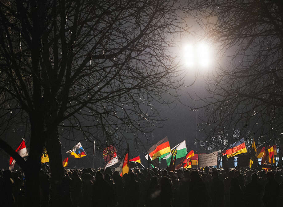 Participants of a rally called 'Patriotic Europeans against the Islamization of the West' (PEGIDA) demonsrate in Dresden, Germany, Monday, Jan. 5, 2015. Over the last three months, the crowds at PEGIDA's demonstrations in the eastern city of Dresden, a region that has few immigrants or Muslims, have swelled from a few hundred to 17,500 just before Christmas. Police said a similar number were expected again Monday night. (AP Photo/Jens Meyer)
