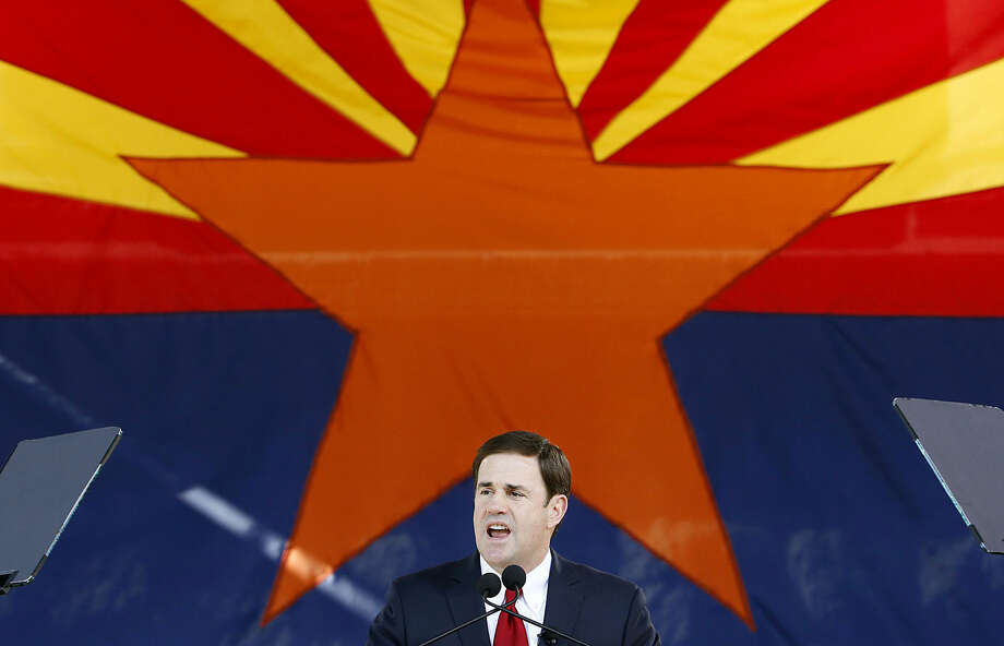 Republican Arizona Gov. Doug Ducey addresses the crowd after being sworn in during inauguration ceremonies at the Arizona Capitol, Monday, Jan. 5, 2015, in Phoenix. (AP Photo/Ross D. Franklin)