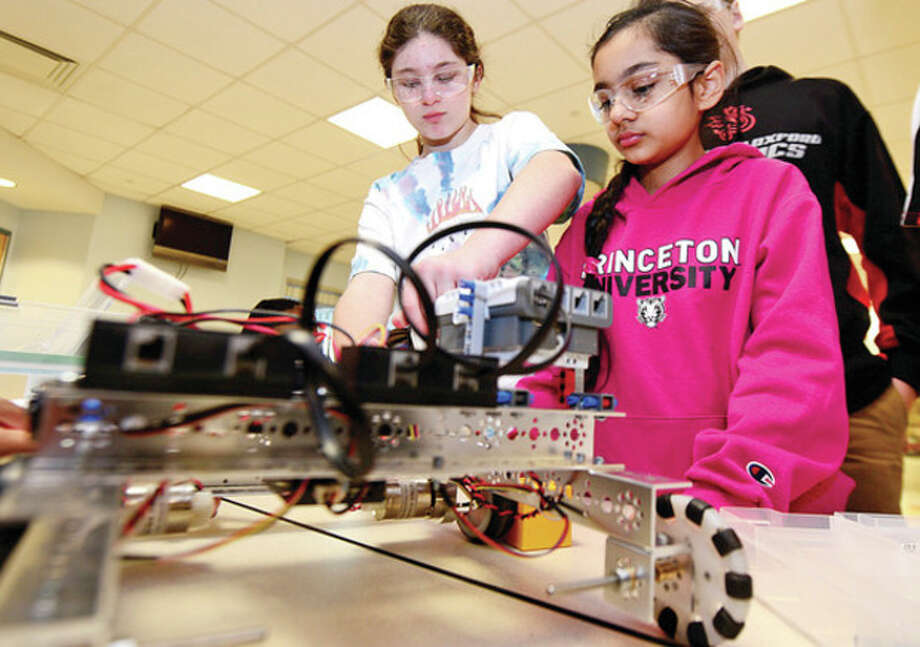 "Norwalk students Lillie Dehaemer, 13, and Sahiba Dhindsa, 11, in a program called Saturday Academy for Girls, engage in their first year of FTC competition as i2robotics hosts a ""robotics scrimmage"" at Staples. / (C)2013, The Hour Newspapers, all rights reserved"