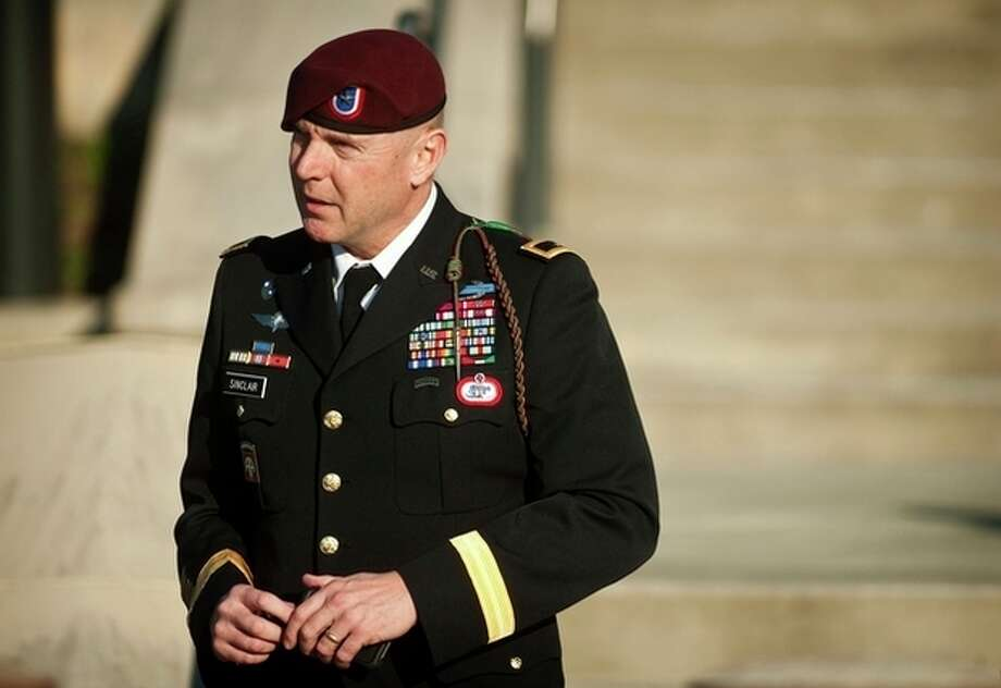 FILE - In this Tuesday, Jan. 22, 2013, file photo, Army Brig. Gen. Jeffrey A. Sinclair leaves a Fort Bragg, N.C., courthouse after he deferred entering a plea at his arraignment on charges of fraud, forcible sodomy, coercion and inappropriate relationships. Sinclair, 51, faces a maximum sentence of life in prison at a court-martial scheduled to begin March 3. (AP Photo/The Fayetteville Observer, Andrew Craft, File) / The Fayetteville Observer