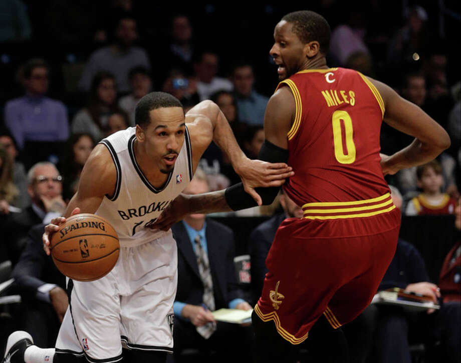 Brooklyn Nets' Shaun Livingston (14) drives past Cleveland Cavaliers' C.J. Miles (0) during the first half of an NBA basketball game on Saturday, Jan. 4, 2014, in New York. (AP Photo/Frank Franklin II) / AP