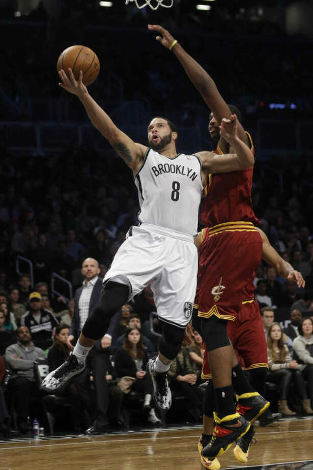 Brooklyn Nets' Deron Williams (8) drives past Cleveland Cavaliers' Tristan Thompson (13) during the first half of an NBA basketball game on Saturday, Jan. 4, 2014, in New York. (AP Photo/Frank Franklin II)
