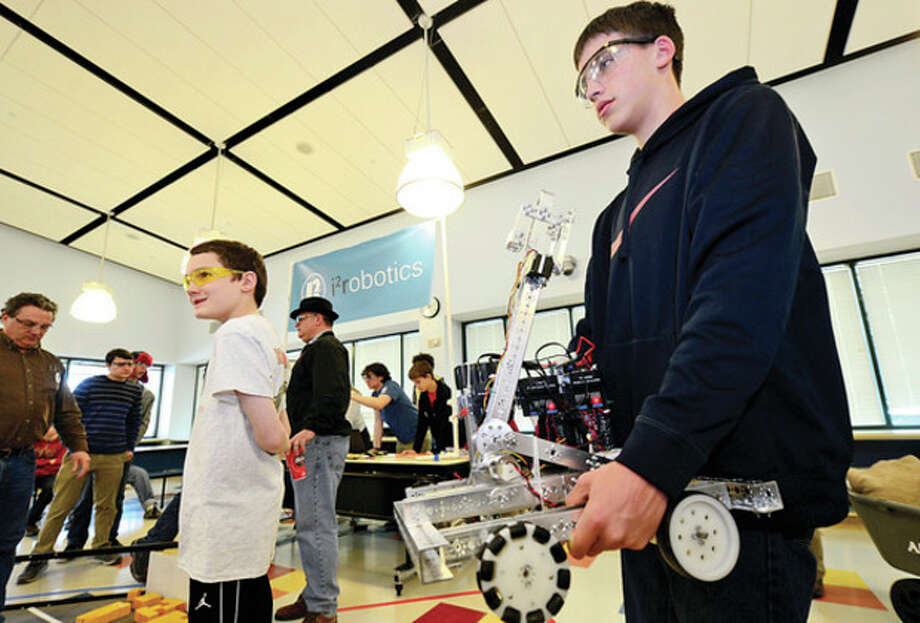 "Hour photo / Erik Trautmann Norwalk resident Ryan Petcheck readies team Dragonoids robot as i2robotics hosts a ""robotics scrimmage"" at Staples Saturday. The event was organized to benefit the Staples PTA Technology Initiative. / (C)2013, The Hour Newspapers, all rights reserved"