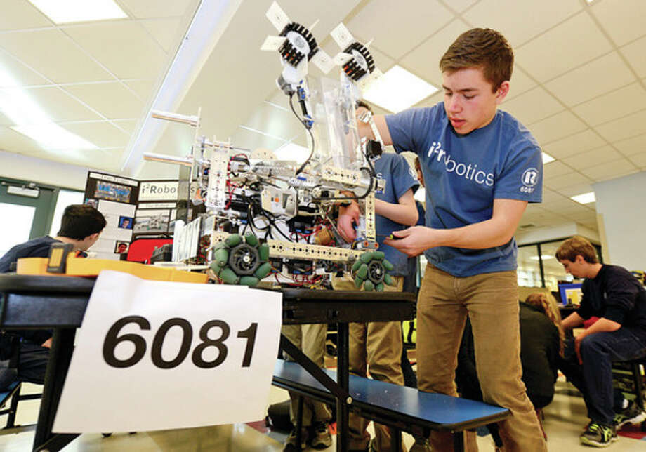"""Hour photos / Erik TrautmannPeter Sauer of i2robotics -- a team composed of Staples High School in Westport and Weston High School students -- works on the team's robot as they host a """"robotics scrimmage"""" at Staples Saturday. The event is organized to benefit the Staples PTA Technology Initiative. / (C)2013, The Hour Newspapers, all rights reserved"""