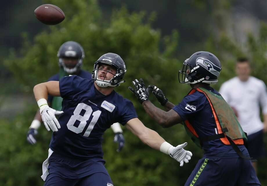 Seattle Seahawks running back Tre Madden, right, reaches for a pass intended for tight end Nick Vannett (81) during NFL football practice, Thursday, June 9, 2016, in Renton, Wash. (AP Photo/Ted S. Warren) Photo: Ted S. Warren/AP