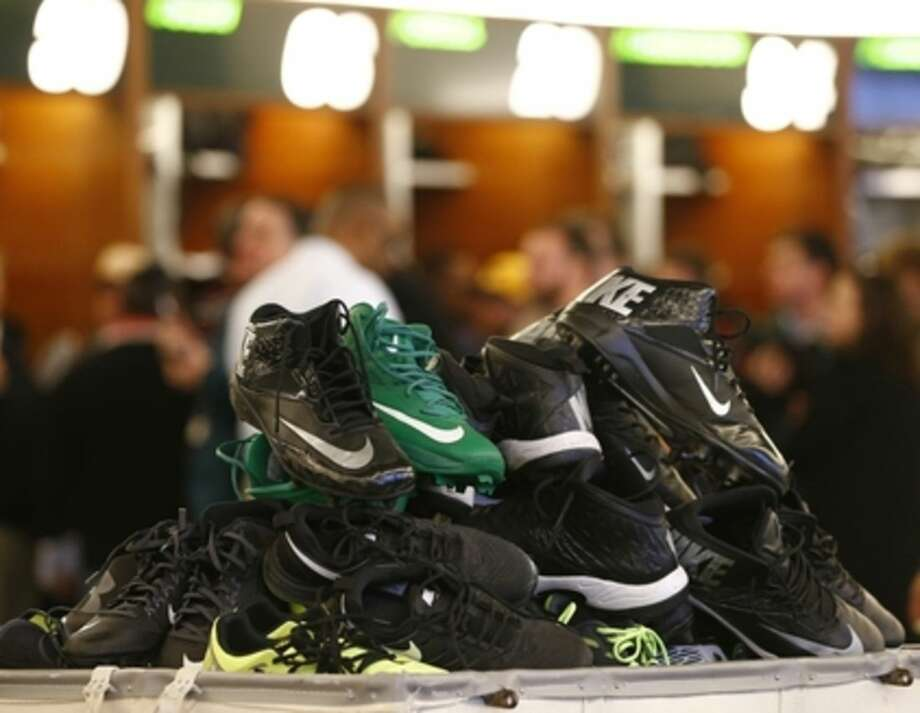A stack of cleats are piled up in the locker room as New York Jets talk to the media and clear out their lockers at the team's NFL football training facility, Monday, Jan.4, 2016, in Florham Park, N.J. (AP Photo/Rich Schultz)