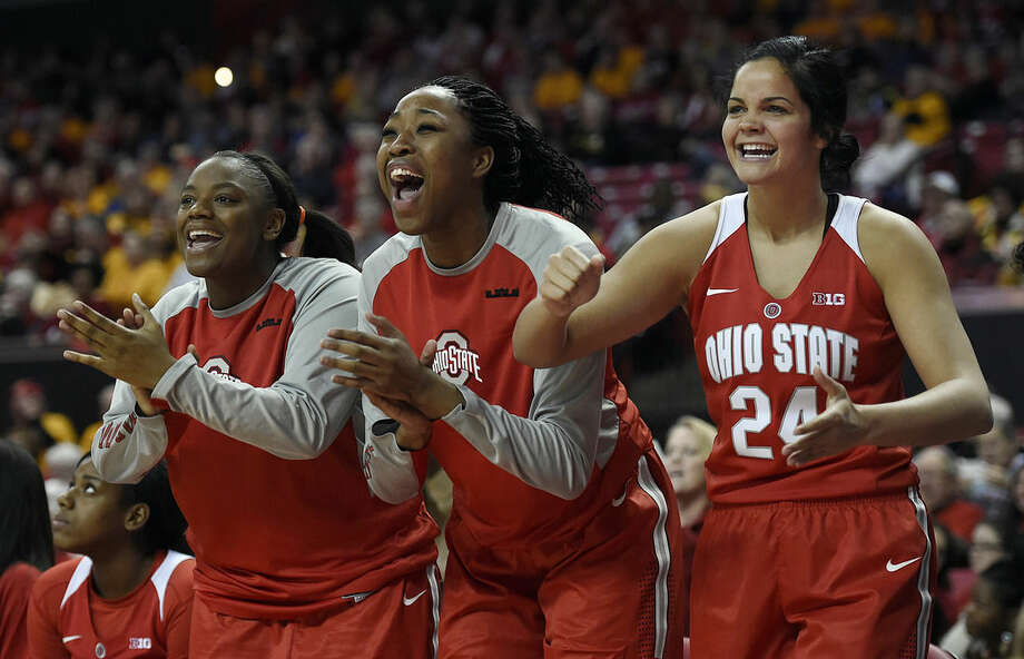 The Ohio State bench including Makayla Waterman, right, cheer their team against Maryland in the first half of an NCAA college basketball game, Saturday, Jan. 2, 2016, in College Park, Md. Ohio State won 80-71. (AP Photo/Gail Burton)