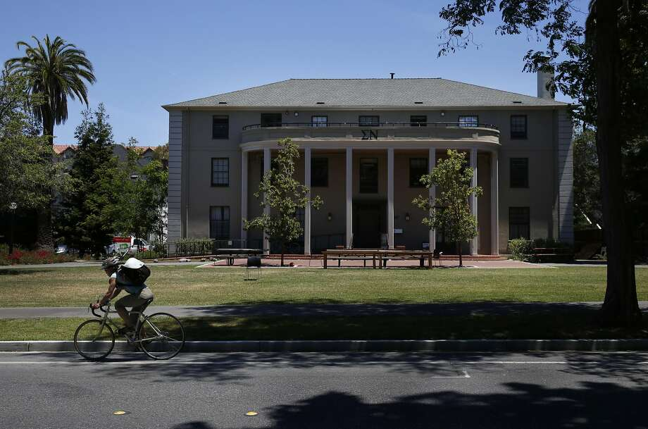 A cyclist rides by the Greek fraternity Sigma Nu on the campus of Stanford University. Many fraternities have been on the defensive since a recent rape case resulted in a six-month sentence for a former Stanford swimmer. Photo: Leah Millis, The Chronicle