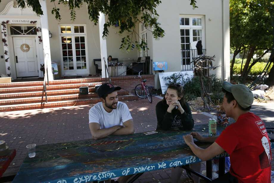 Madeleine Rowell (center) chats with friends Ted Ford (left) and David Lim. The Stanford sophomore, who belongs to a group that provides support to rape victims, says that she can't say the campus is safe. Photo: Leah Millis, The Chronicle