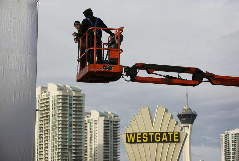 Workers inspect a temporary structure in preparation for the International CES gadget show Sunday, Jan. 3, 2016, in Las Vegas. The show kicks off Wednesday, Jan. 6. (AP Photo/John Locher)