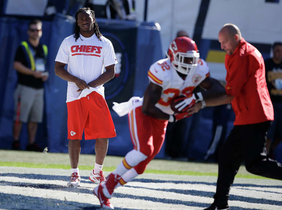 Kansas City Chiefs running back Jamaal Charles, left, looks on as teammate running back Cyrus Gray, second from right, warms up before playing the San Diego Chargers in an NFL football game Sunday, Dec. 29, 2013, in San Diego. (AP Photo/Lenny Ignelzi) / AP