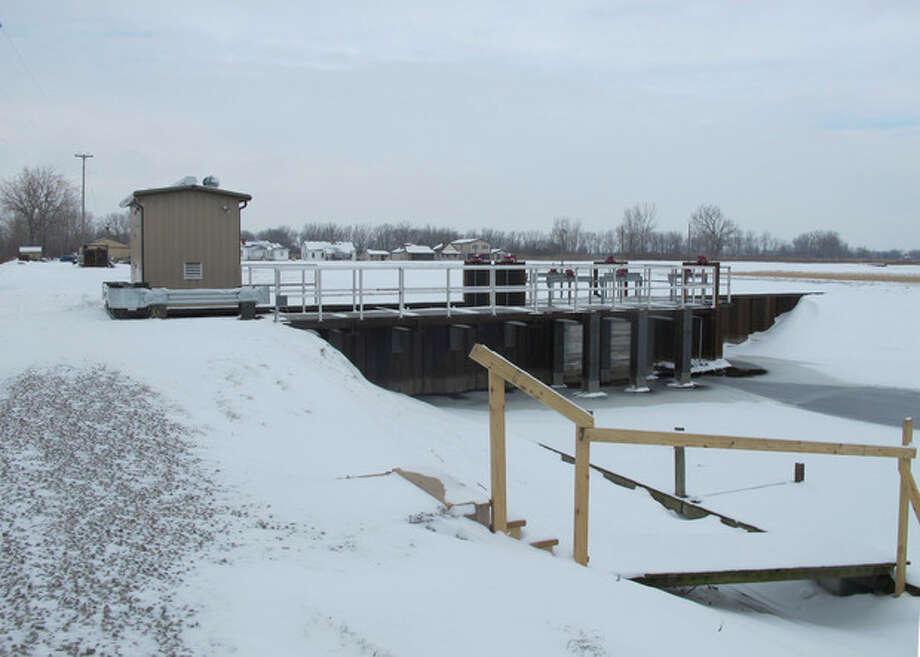 This photo taken Dec. 17, 2013, shows a newly installed gate and pump house at Erie Marsh near Monroe, Mich., where The Nature Conservancy and Ducks Unlimited are installing infrastructure to boost water levels and enhance fish passage between the wetland and Lake Erie's Maumee Bay. A recent federal report found that the Great Lakes region was the only area of the nation that gained wetland acreage during a five-year period, partly because of similar restoration projects. (AP Photo/John Flesher) / AP