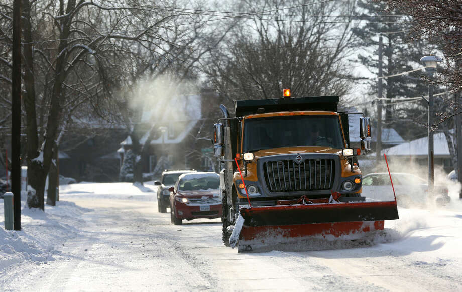 A City of Dubuque snowplow removes snow on Tuesday, Jan. 6, 2015, along South Grandview Avenue in Dubuque, Iowa. A winter storm system moved through the Midwest which brought snow and cold temperatures to parts of Nebraska and Iowa. (AP Photo/Telegraph Herald, Jessica Reilly)
