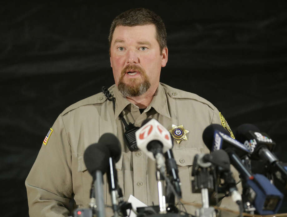 "Harney County Sheriff David Ward speaks to the media on Monday, Jan. 4, 2016, in Burns, Ore. Ward said the father and son ranchers convicted of setting fire to federal grazing land have reported to prison. A group calling itself Citizens for Constitutional Freedom sent a ""demand for redress"" to local, state and federal officials as they occupied a federal wildlife reserve. (AP Photo/Rick Bowmer)"