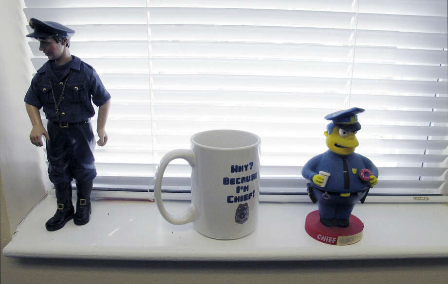 In this Dec. 11, 2015 photo, keepsakes sit on a window sill in the office of Newtown Police Chief Michael Kehoe in Newtown, Conn. Kehoe is retiring Jan. 6, 2016, after 37 years with the town police department. He will be best remembered for leading the response to the Sandy Hook Elementary School shooting on Dec. 14, 2012, that killed 20 children and six educators. (AP Photo/Dave Collins)
