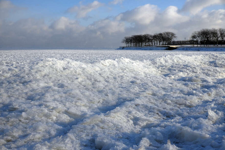 Blocks of ice pile up along Lake Michigan near Ohio Street Beach, Monday, Jan. 5, 2015, in Chicago. Forecasters expect significant snowfall and continued freezing temperatures this week in northern Illinois. (AP Photo/Kiichiro Sato)