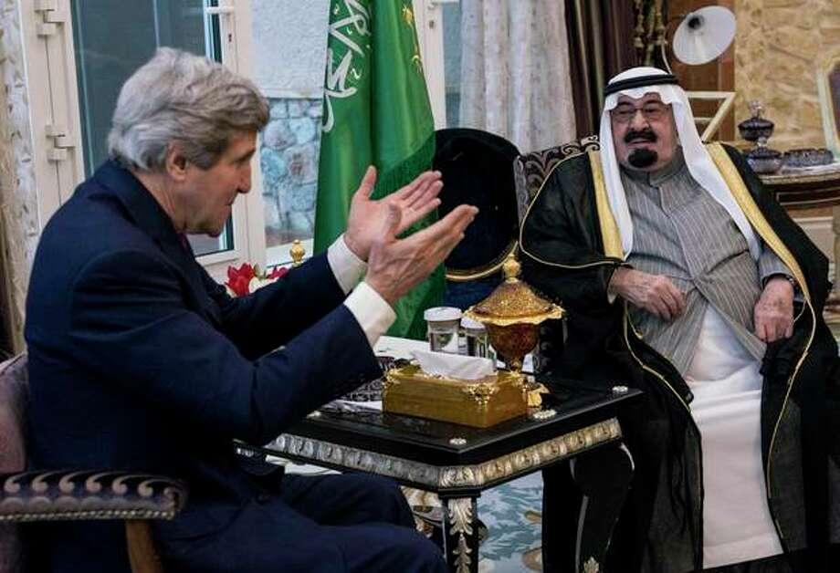 U.S. Secretary of State John Kerry, left, speaks with Saudi Arabia's King Abdullah before their meeting in Rawdat Khurayim, a secluded royal hunting retreat in Saudi Arabia, Sunday, Jan. 5, 2014. (AP Photo/Brendan Smialowski, Pool) / POOL AFP