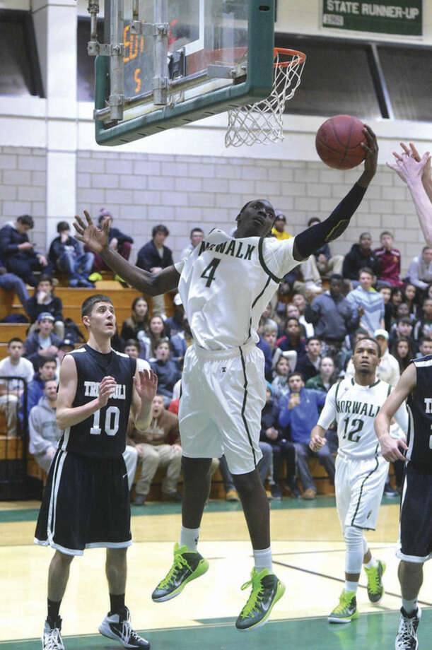 Hour photo/Alex von KleydorffNorwalk's Roy Kane Jr. (4) grabs a rebound during Tuesday night's game against Trumbull at Norwalk High School. The Bears won to stay undefeated.