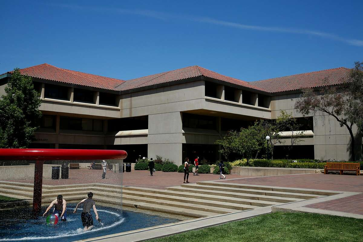 People play in the Red Hoop Fountain outside of the Cecil H Green Library on the campus of Stanford University June 9, 2016 in Stanford, Calif.