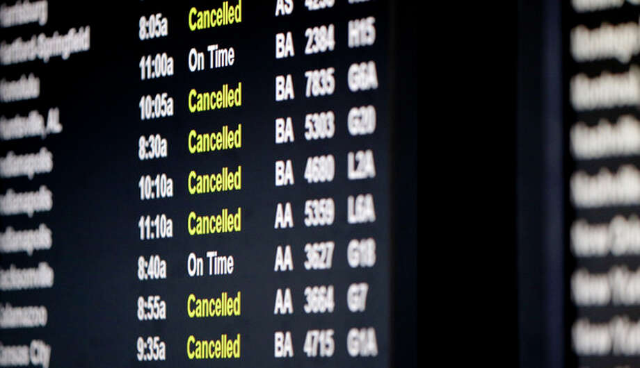 A screen displays flights information at O'Hare International Airport in Chicago on Sunday, Jan. 5, 2014. Temperatures not seen in years are likely to set records in the coming days across the Midwest, Northeast and South, creating dangerous travel conditions and prompting church and school closures. (AP Photo/Nam Y. Huh) / AP