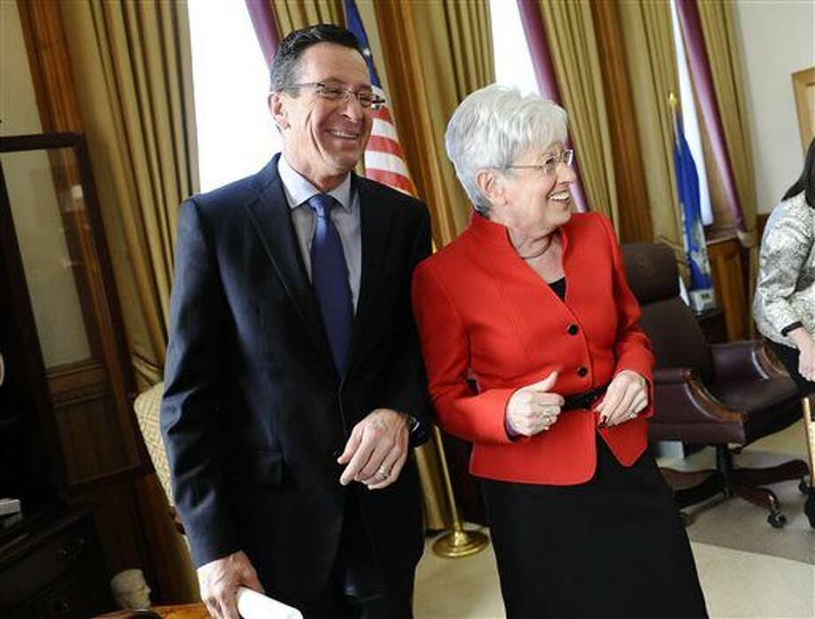 Connecticut Gov. Dannel P. Malloy, left, and Lt. Gov. Nancy Wyman, right, share a light moment as they wait in her office for Wyman to be sworn in of a second term at the State Capital, Wednesday, Jan. 7, 2015, in Hartford, Conn.