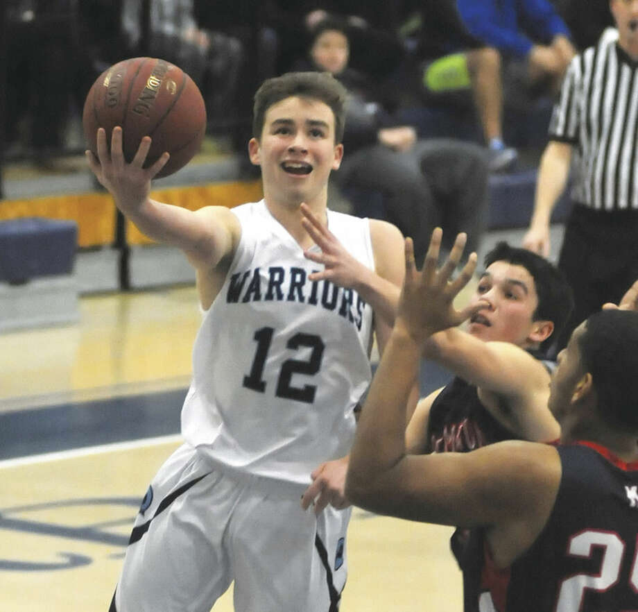 Hour photo/John NashRichie Williams (12) of Wilton soars to the bucket for a lay-up during Tuesday's game at the Zeoli Field House in Wilton. The host Warriors defeated the Senators 78-69.