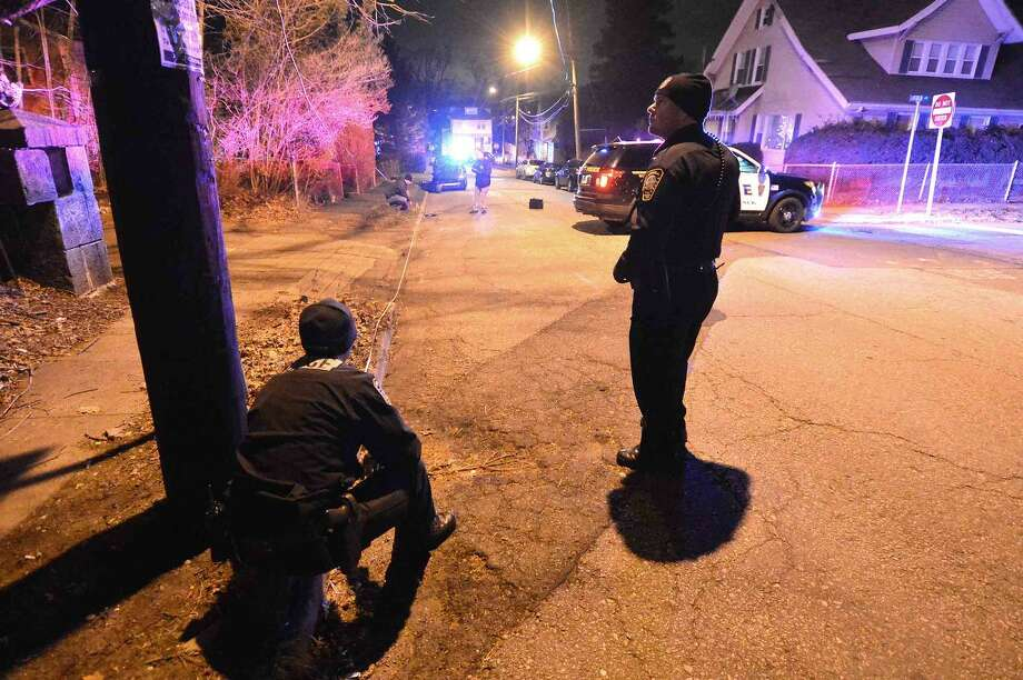 Hour Photo/Alex von Kleydorff Norwalk Police investigate an area on Sheridan St Friday night, possibly connected to a shooting in the area